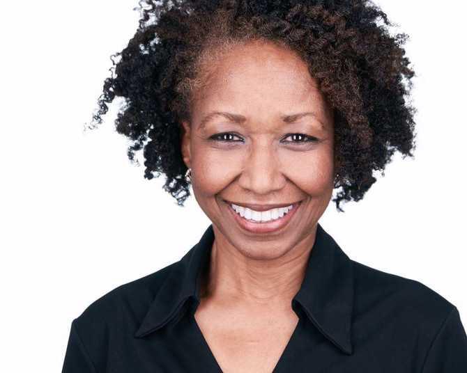 Smiling White Background Corporate Headshot